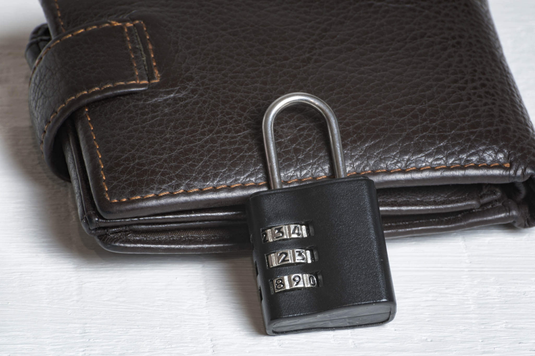 Leather wallet with a combination lock. Safe storage of money. Financial security